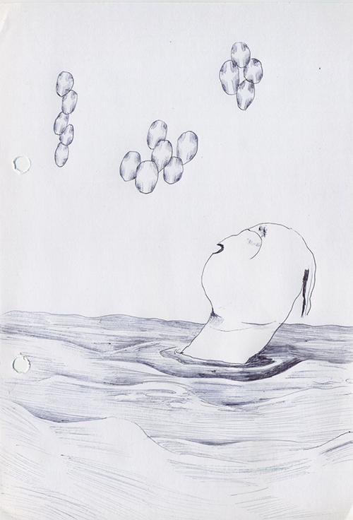 海の中で光る米粒を見ている